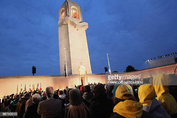 Australians visitors attend a dawn service commemorating Anzac Day on the WWI battlefield of VillersBretonneux northern France on April 25 2010 Anzac...