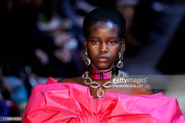 AustralianSudanese model Adut Akech presents a creation by Alexander McQueen during the Women's FallWinter 2019/2020 ReadytoWear collection fashion...