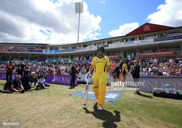 Australia's Aaron Finch and Australia's Travis Head take to the field to open batting on the fourth One Day International cricket match between...