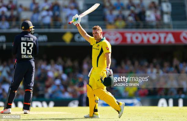 Australia's Aaron Finch celebrates his century during the 2nd oneday international cricket match between England and Australia in Brisbane on January...