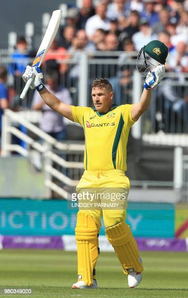 Australia's Aaron Finch celebrates his century during the fourth One Day International cricket match between England and Australia at The Riverside...