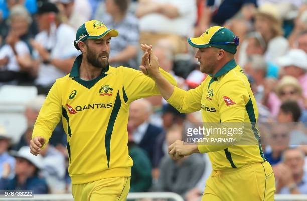 Australia's Aaron Finch celebrates making the catch to take the wicket of England's Jos Buttler for 11 during the third OneDay International cricket...