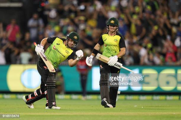 Australia's Aaron Finch celebrates the Aussies 3rd series win with D'Arcy Short during the Twenty20 International TriSeries cricket match between...