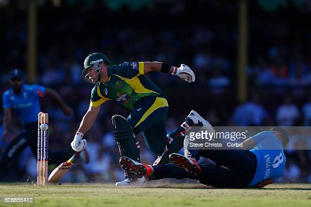 Australia's Aaron Finch makes his ground during a runout attempt by England's Stuart Broad at the Sydney Cricket Ground. Sydney Australia. Friday,...