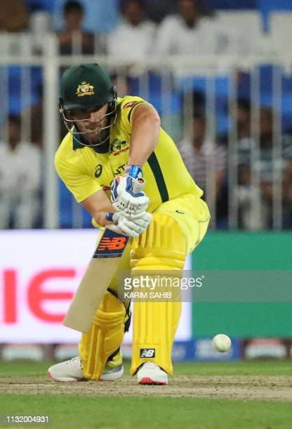 Australia's Aaron Finch plays a shot during the first oneday international cricket match between Pakistan and Australia at Sharjah Cricket Stadium in...