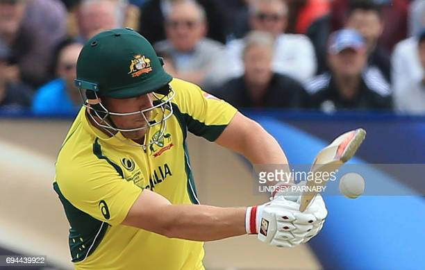 Australia's Aaron Finch plays a shot during the ICC Champions Trophy match between England and Australia at Edgbaston in Birmingham on June 10 2017 /...