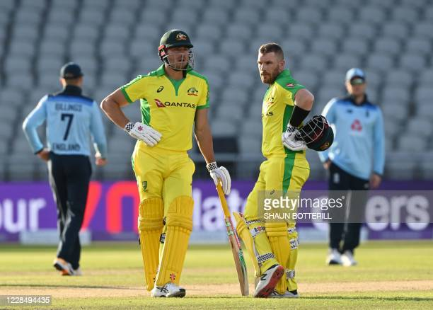 Australia's Aaron Finch stands with Australia's Marcus Stoinis after being hit on the helmet during the one-day international cricket match between...