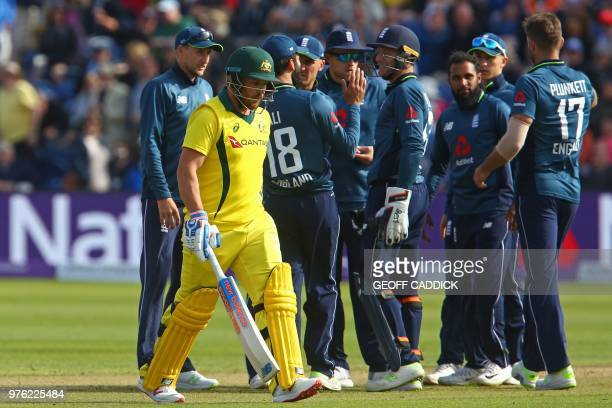 Australia's Aaron Finch walks back to the pavilion after losing his wicket for 0 runs during play in the 2nd One Day International cricket match...