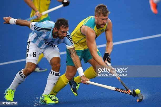 Australia's Aaron Kleinschmidt vies for the ball with Nahuel Salis of Argentina during their men's field hockey match of the 2018 Sultan Azlan Shah...