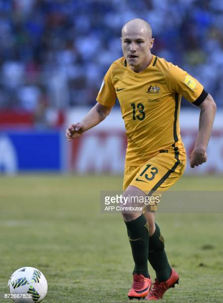 Australia's Aaron Mooy drives the ball during the first leg football match of their 2018 World Cup qualifying playoff against Honduras in San Pedro...