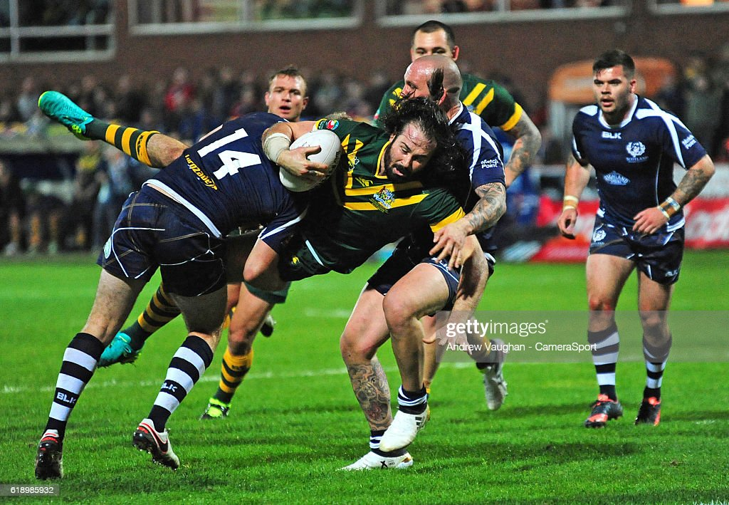 Australia's Aaron Woods is tackled by Scotland's Ben Hellewell during the Four Nations match between the Australian Kangaroos and Scotland at Lightstream Stadium on October 28, 2016 in Hull, United Kingdom.