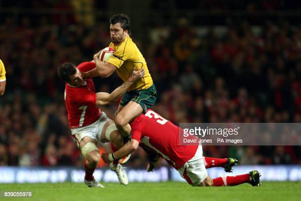 Australia's Adam Ashley Cooper is tackled by Wales' Sam warburton and Scott Andrews during the International match at the Millennium Stadium Cardiff