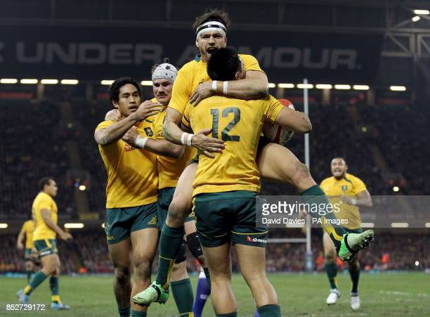 Australia's Adam AshleyCooper celebrates with Christian Leali'ifano after scoring the first try during the Dove Men Series at the Millennium Stadium...