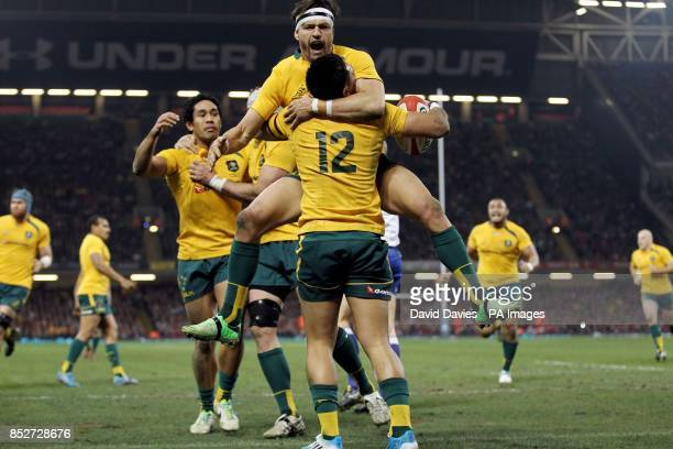 Australia's Adam AshleyCooper congratulates Christian Leali'ifano after scoring the first try during the Dove Men Series at the Millennium Stadium...