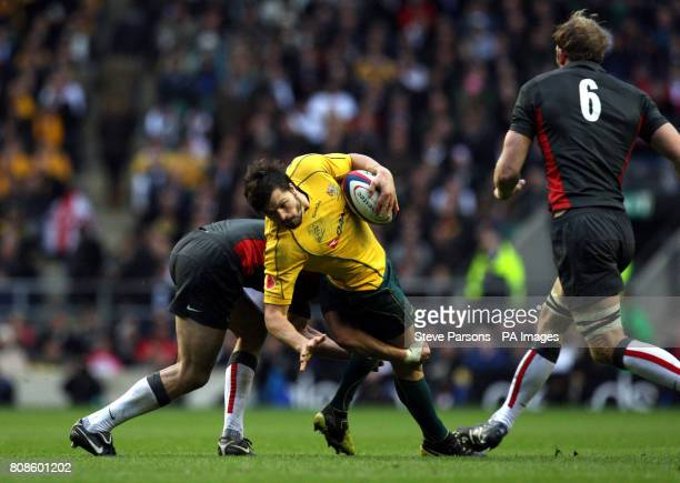 Australia's Adam AshleyCooper is halted during the Investec Challenge Series match at Twickenham London Picture date Saturday November 13 2010