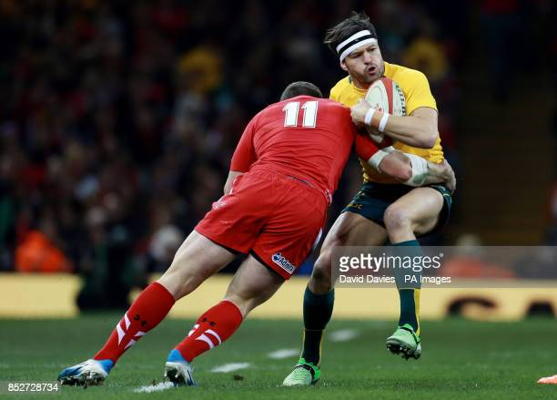 Australia's Adam AshleyCooper is tackled by Wales George North during the Dove Men Series at the Millennium Stadium Cardiff