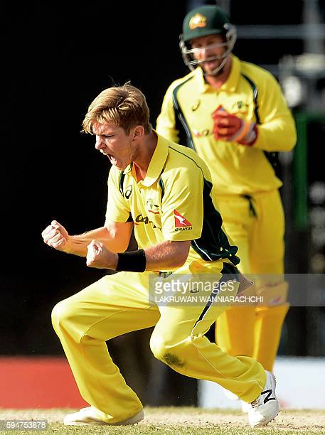 Australia's Adam Zampa celebrates with wicketkeeper Matthew Wade after he dismissed unseen Sri Lankan batsman Kusal Mendis during the second oneday...