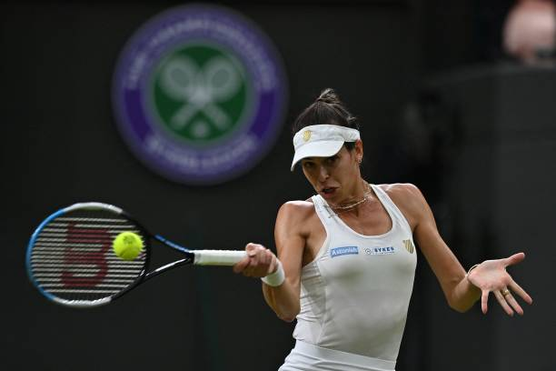 Australia's Ajla Tomljanovic returns against Britain's Emma Raducanu during their women's singles fourth round match on the seventh day of the 2021...