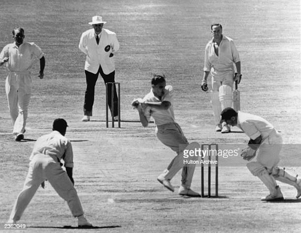 Australia's Alan Davidson misses a ball from John Wardle and it is taken by England wicket keeper Godfrey Evans during Australia's 2nd innings in the...