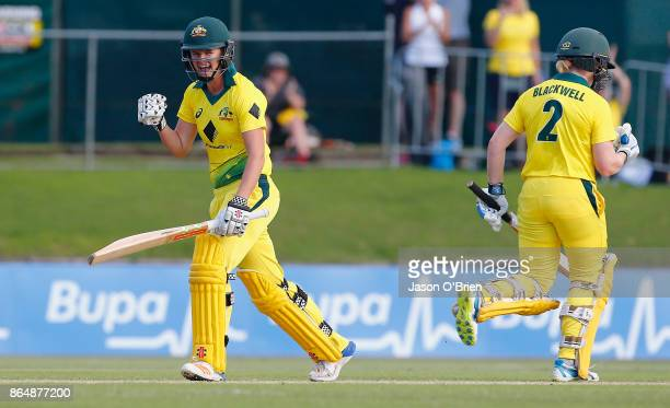 Australia's Alex Blackwell and Jess Jonassen celebrate after victory during the Women's One Day International between Australia and England at Allan...