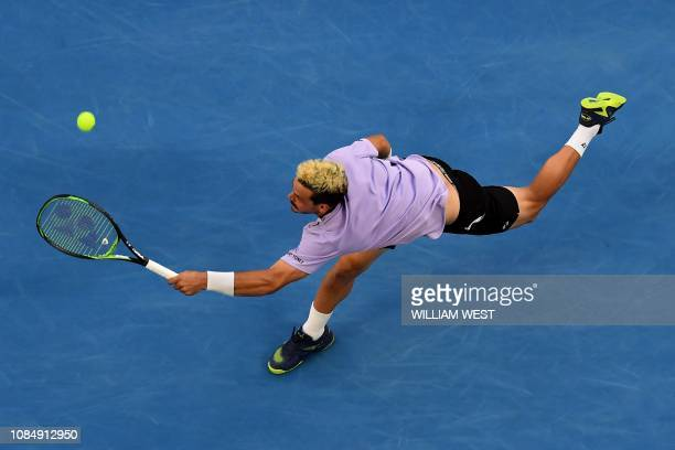 Australia's Alex Bolt hits a return against Germany's Alexander Zverev during their men's singles match on day six of the Australian Open tennis...