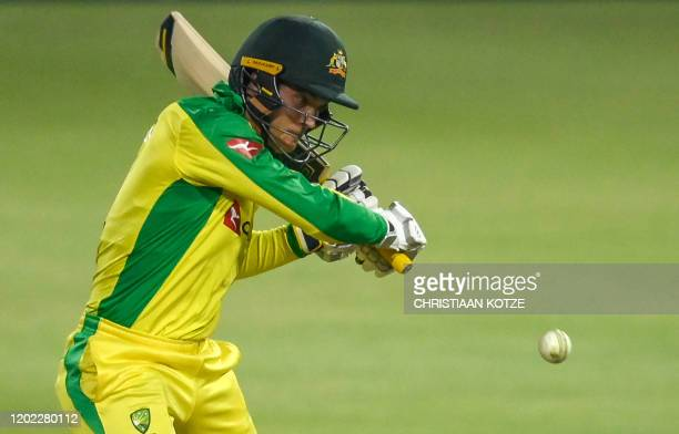 Australia's Alex Carey playing a shot during the first T20 international cricket match between South Africa and Australia at The Wanderers Stadium in...