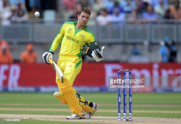 TOPSHOT Australia's Alex Carey reacts after being hit by a bouncer from England's Jofra Archer during the 2019 Cricket World Cup second semifinal...
