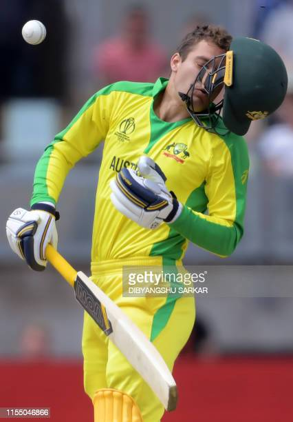 Australia's Alex Carey reacts after being hit by a bouncer from England's Jofra Archer during the 2019 Cricket World Cup second semifinal between...