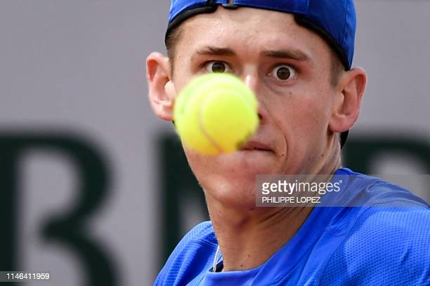 Australia's Alex De Minaur eyes the ball before hitting a return to Bradley Klahn of the US during their men's singles first round match on day two...