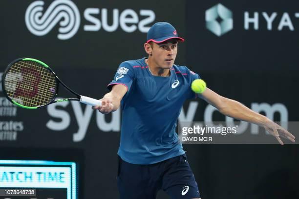 Australia's Alex De Minaur hits a return against Dusan Lajovic of Serbia during their men's singles first round match at the Sydney International...