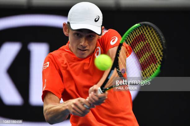 Australia's Alex de Minaur hits a return against Switzerland's Henri Laaksonen during their men's singles match on day three of the Australian Open...