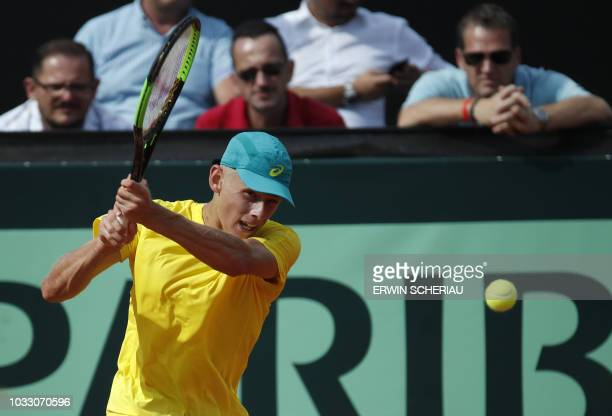 Australia's Alex De Minaur returns the ball to Austria's Dennis Novak during their Davis Cup Playoff tennis match between Austria and Australia on...