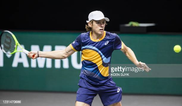 Australia's Alex de Minaur returns to compatriot John Millman on the second day of the Rotterdam ATP tennis tournament, on March 2, 2021. /...