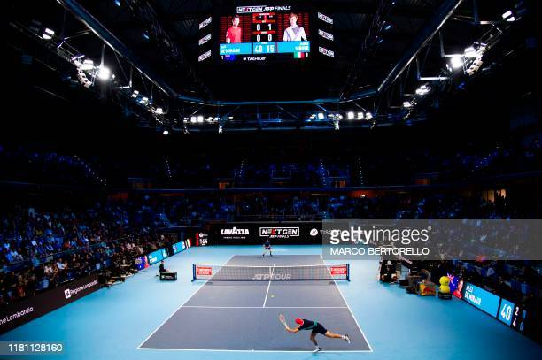 Australia's Alex De Minaur returns to Italy's Jannik Sinner during the final of the Next Generation ATP Finals at the Allianz Cloud Court on November...