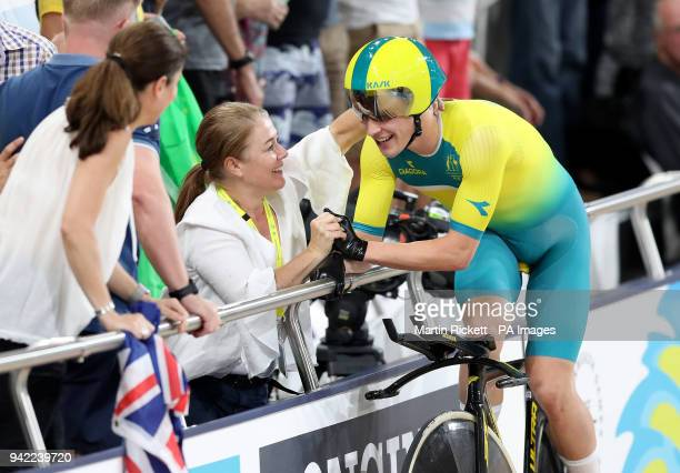 Australia's Alex Porter celebrates with his mother after the Men's 4000m Team Pursuit Finals Gold Medal Race at the Anna Meares Velodrome during day...