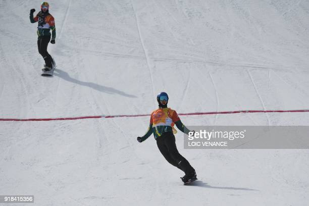 Australia's Alex Pullin reacts after winning a men's snowboard cross semifinal ahead of Australia's Jarryd Hughes at the Phoenix Park during the...