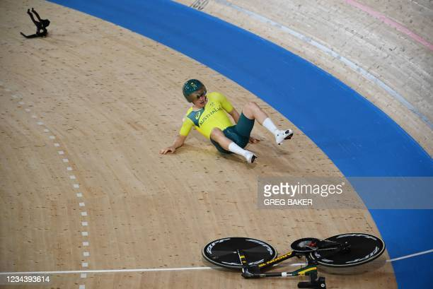 Australia's Alexander Porter reacts after crashing during the men's track cycling team pursuit qualifying event during the Tokyo 2020 Olympic Games...