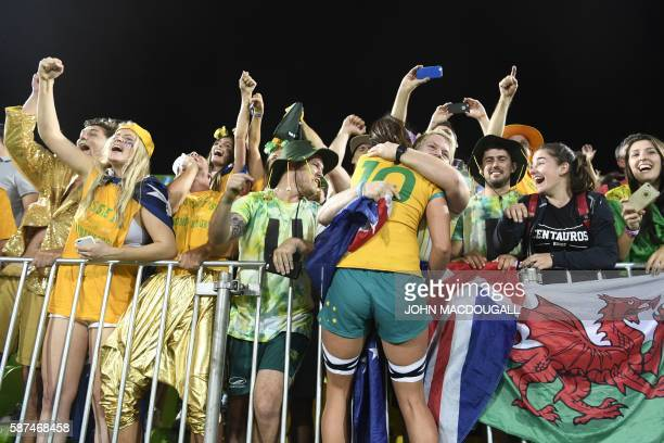 TOPSHOT Australia's Alicia Quirk celebrates with a supporter after victory in the womens rugby sevens gold medal match between New Zealand and...