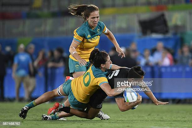 Australia's Alicia Quirk tackles New Zealand's Gayle Broughton in the womens rugby sevens gold medal match between New Zealand and Australia during...