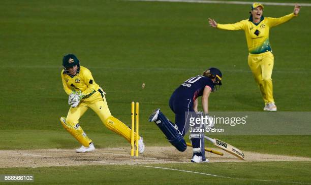 Australia's Alyssa Healy attempts unsuccessfully to run out Sarah Taylor during the Women's One Day International match between Australia and England...