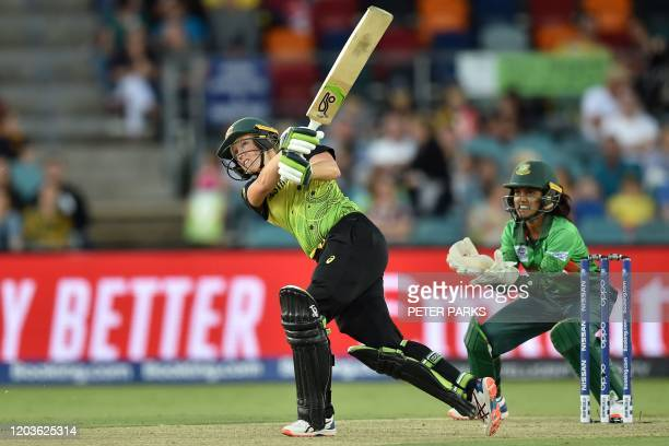 Australia's Alyssa Healy hits a six during the Twenty20 women's World Cup cricket match between Australia and Bangladesh in Canberra on February 27,...