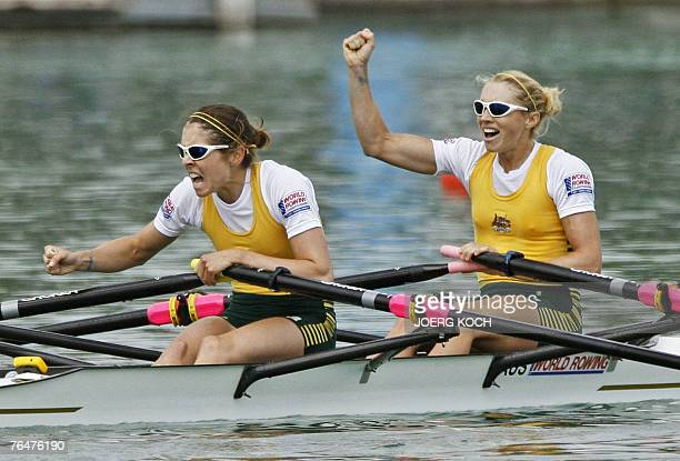 Australia's Amber Halliday and Marguerite Houston celebrate their victory in the lightweight women's double sculls final race of the Rowing World...