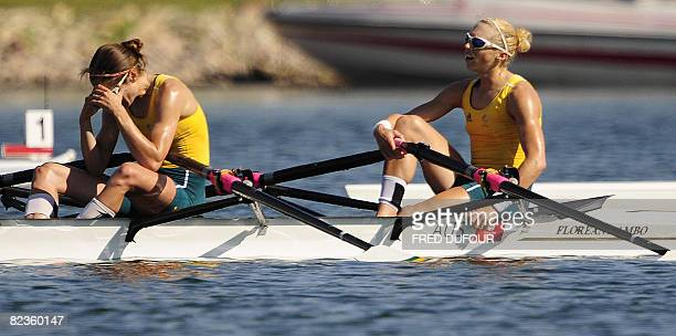 Australia's Amber Halliday and Marguerite Houston react after finishing the lightweight women's double sculls semifinal A/B 2 at the Shunyi Rowing...