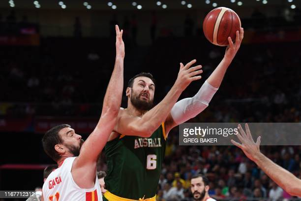 TOPSHOT Australia's Andrew Bogut goes for the basket as Spain's Marc Gasol tires to block during the Basketball World Cup semifinal game between...