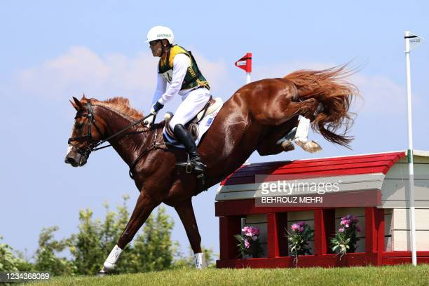 Australia's Andrew Hoy riding Vassily de Lassos competes in the equestrian's eventing team and individual cross country during the Tokyo 2020 Olympic...