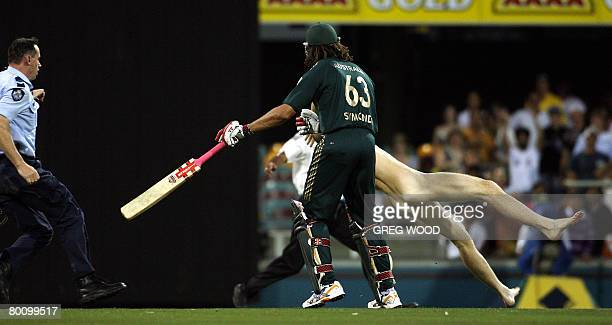 Australia's Andrew Symonds clashes with a streaker during the second final in the oneday triangular series cricket match in Brisbane on March 4 2008...
