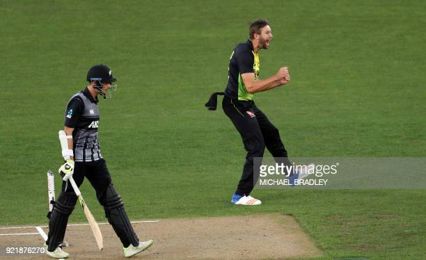 Australia's Andrew Tye celebrates after taking the wicket of New Zealand's Mitchell Santner during the final Twenty20 Tri Series international...