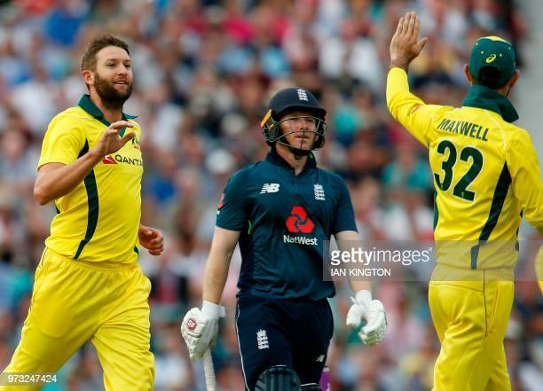 Australia's Andrew Tye celebrates taking the wicket of England's Eoin Morgan for 69 runs during the first One Day International cricket match between...
