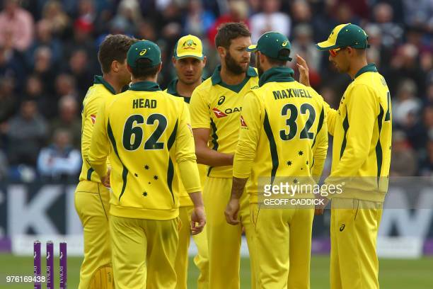 Australia's Andrew Tye celebrates with teammates after taking the wicket of England's Sam Billings during play in the 2nd One Day International...