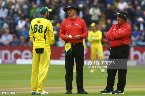 Australia's Andrew Tye discusses the condition of the ball with umpires Alex Wharf and Marais Erasmus during play in the 2nd One Day International...